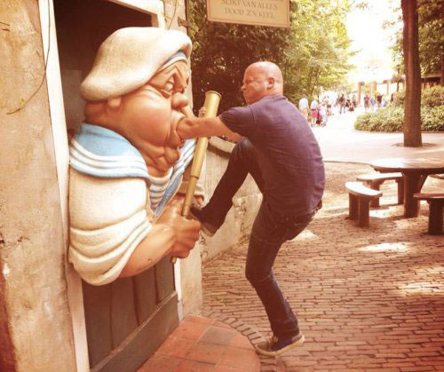 man insert hand on statue mouth