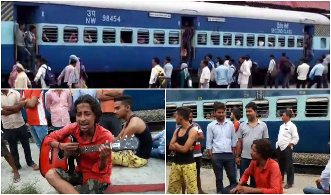 A Train Passenger Singing Super Hit Songs With Guitar On A Railway Station Video Viral hindi rasayan
