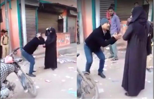 मनचले अंकल को बुर्का बेग़म छेड़ना पड़ा भारी, हो गई हेलमेट से पिटाई ( pakistani burqa woman beat a man with a helmet )