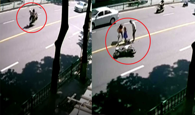 a family on a motorcycle sprung with 360 degrees in the air at southeast China road