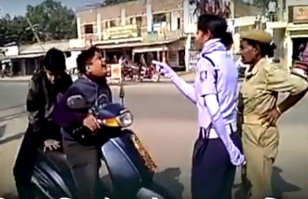 वीडियो : महिला ट्रैफिक कॉन्सटेबल द्वारा स्कूटी चलाते पकड़े जाने पर सुनिए क्या कहता है,नाबालिक बच्चा ( traffic police caught a small boy riding bike viral funny video )