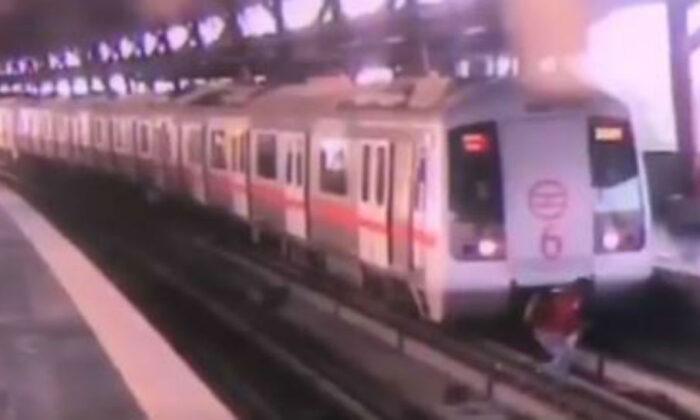 मौत के बेहद करीब था युवक, फिर हुआ कुछ ऐसा जो सीसीटीवी में हो गया कैद ( viral video delhi narrow escape for 21 year old mayur patel as train moved while he was crossing the track at shastri nagar metro station )