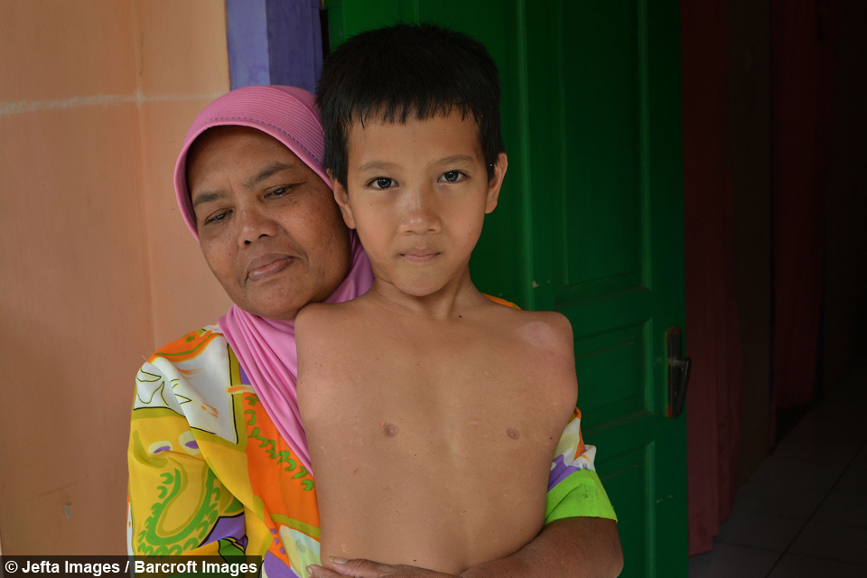 Tiyo Satrio with his Mother
